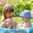 Two children in the bath on the nature — Stock Photo