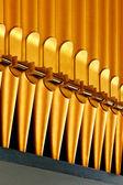 Golden organ pipes — Stock Photo