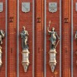 Sculptures on the facade of the House of Blackheads in Riga. — Stock Photo #19989153