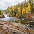 Stock Photo: Flowing Lapland mountain river in autumn