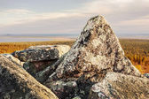 Powerful grantite rocks on top of a mountain — Stok fotoğraf