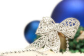 Christmas composition with silver bow and blue balls — Stock Photo