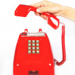 Stock Photo: Red old-fashioned phone on white background