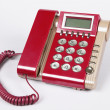 Zdjęcie stockowe: Red old-fashioned phone on white background