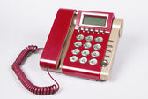 Telefono vecchio stile rosso su sfondo bianco — Foto Stock