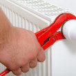 Man fixing radiator — Stock Photo