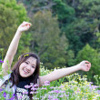 Asian woman relaxing in the flowers garden — Stock Photo #22014717