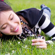Asian woman relaxed on the grass - Stock Photo