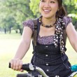 Royalty-Free Stock Photo: Asian woman riding bicycle