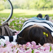 Asian woman sleeping on the grass — Stock Photo