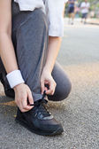 Tying sport shoes — Stock Photo