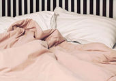 Pillowand blanket on the bed — Stock Photo