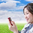 Woman chatting with mobile phone — Stock Photo