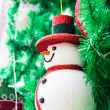Snowman on christmas tree — Stock Photo