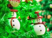 Snowman on christmas tree — Stock Photo