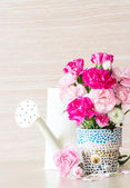 Carnation in mosaic flower pot — Stock Photo