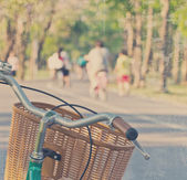 Bicycle in the park. Vintage style. — Stock Photo