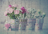 Carnation in mosaic flower pot. Vintage style. — Stock Photo