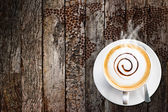 Coffee cup and saucer on old wood background — Stock fotografie