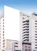 Blank billboard on the building — Stock Photo