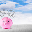 Pink piggy bank and icons design to represent the concept of saving money — Stock Photo