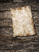 Old paper on wood background. Vintage style. — Photo