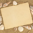 Stock Photo: Old postcard on sand whith seashells