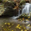 Stock Video: Waterfall time lapse in autumn