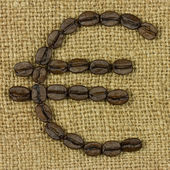 Euro symbol from coffe beans on sack — Stock Photo