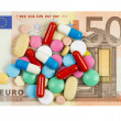 Fifty euro banknote whith pills on it isolated on white backgrou — Stock Photo #27302929
