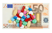 Fifty euro banknote whith pills on it isolated on white backgrou — Stock Photo