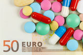 Fifty euro banknote whith pills on it — Stock Photo