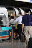 Maglev train - commuters boarding Shanghai maglev train, motion — Stock Photo