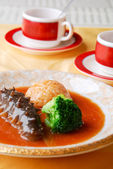 Chinese food sea cucumber and rice — Stock Photo