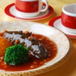 Chinese food sea cucumber and rice — Stock Photo #20324111