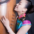 Young women and Chinese zither — Stock Photo