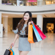 A young woman shopping in mall — 图库照片