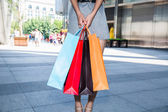 Woman with shopping bags — Stok fotoğraf
