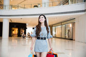 A young woman shopping in mall — Stock Photo