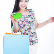 Young woman with shopping bags and credit card on a white backgr — Stock Photo #47993671