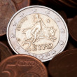 Greek two euros coin among  coins of five cents  — Stock Photo