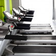 Stock Photo: High technology motorized Treadmills in row