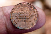 One drachmas the old Greek coin on human finger (macro shot) — Stock Photo