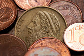 Old greek coin among euro coins, drachmas — ストック写真