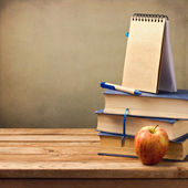 Old books with apple and note book — Stock Photo