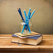 Old vintage book, note book and blue pencils — Stock Photo