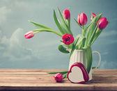 Beautiful tulip bouquet with heart shape box — Stock Photo