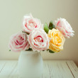 Beautiful rose bouquet on white table — Stock Photo