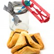 Stock Photo: Hamantaschen cookies and grogger