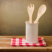 Kitchen utensils with tablecloth — Stock Photo